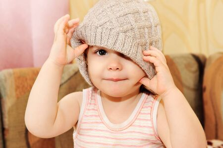 close knit: Close up portrait of adorable baby wearing  knit winter cap Stock Photo