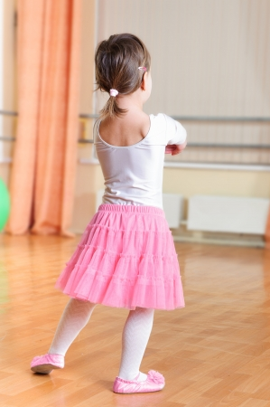 Cute little ballet dancer at training class  photo