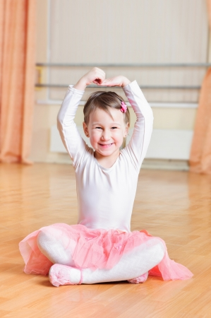 Cute little ballerina training at ballet class photo