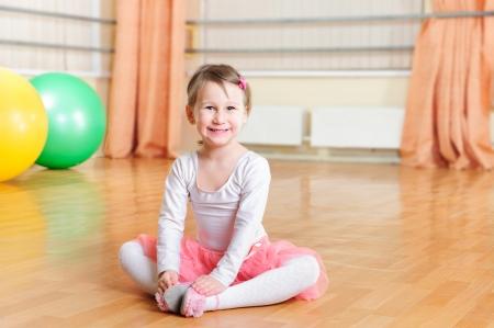 Cute little ballerina training at ballet class photo