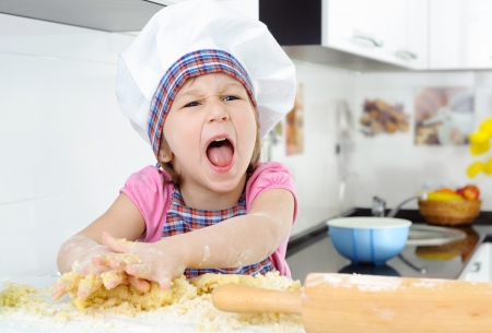 hysterics: Little angry baker screaming in the kitchen Stock Photo