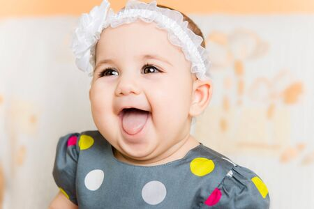 Portrait of beautiful happy baby girl with white flower on head Stock Photo - 18122997