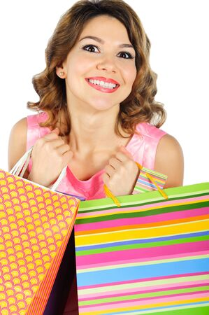 Young cheerful girl with colorful shopping bags isolated on white background photo