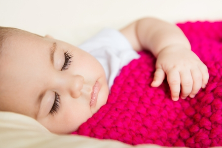 baby sleeping: Closeup portrait of sleeping baby covered with knitted blanket Stock Photo