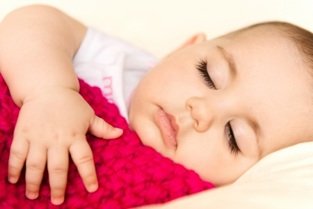 Closeup portrait of a sleeping baby girl Stock Photo - 18411296