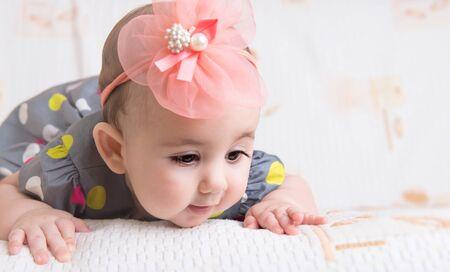 crawl: Beautiful baby girl with flower on head crawling