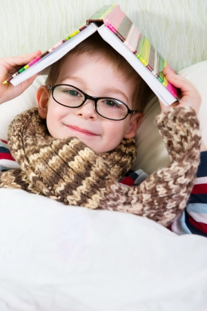 warm home: sick boy on bed