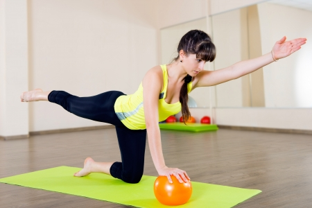 fit ball: Pretty young girl fitness workout with little ball