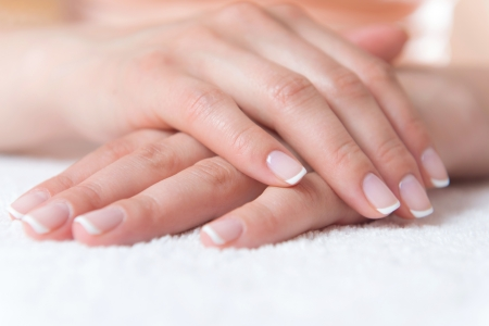 Beautiful womans hand with perfect nail french manicure