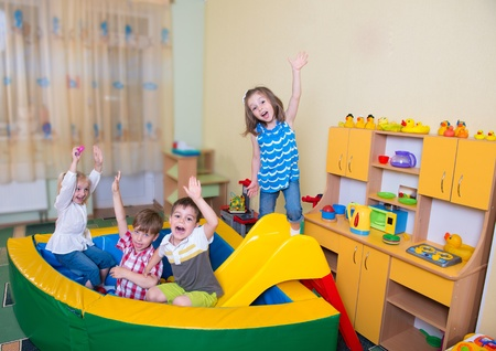 play room: Happy excited children having fun at home Stock Photo