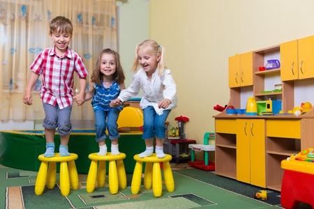 Happy excited children having fun at home Standard-Bild