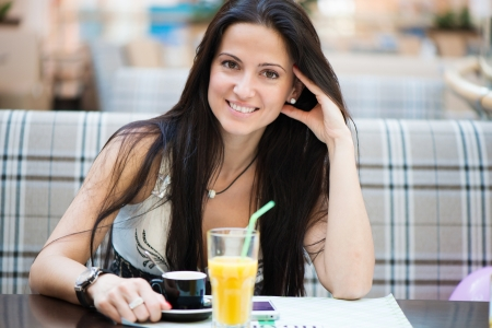 Portrait of beautiful latin woman drinking coffee in cafe Stock Photo - 19783553