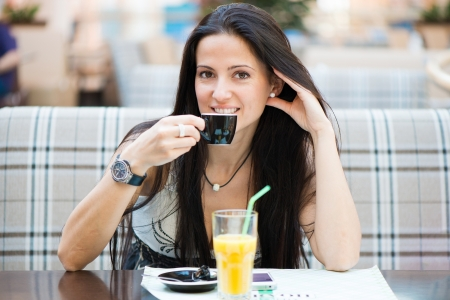 Portrait of beautiful latin woman drinking coffee in cafe Stock Photo - 19783555