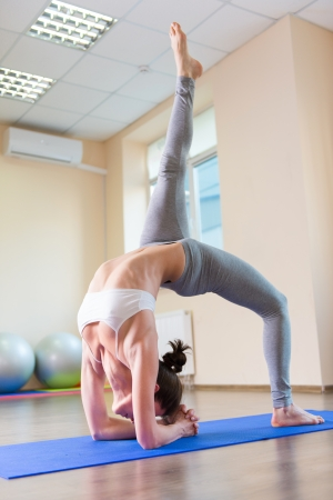 pilate: Young pretty girl exercising in gym