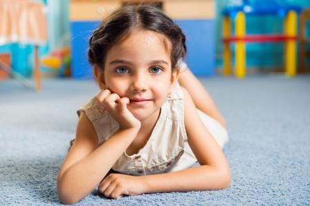 Beautiful little latin girl portrait in daycare photo