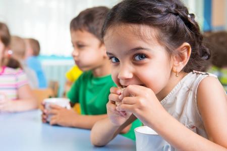 preschool: Cute little children drinking milk at daycare