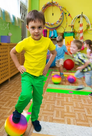 physical activity: Cute little children playing at daycare gym