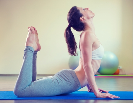 floor mat: Beautiful young woman yoga workout in gym Stock Photo