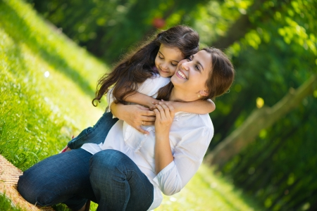 mother and daughter: Happy young mother with her daughter at park Stock Photo