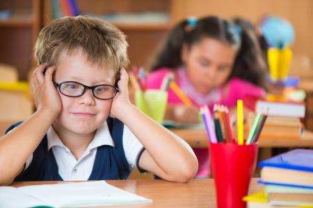 grade: Cute schoolchildren during lesson in classroom at school Stock Photo