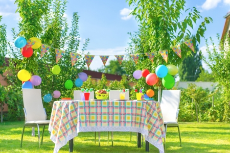 Prepared birthday table in summer green garden photo