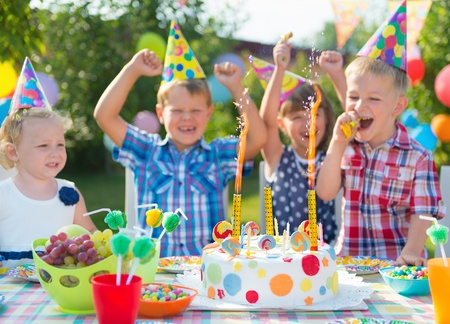 birthday hat: Group of adorable kids having fun at birthday party