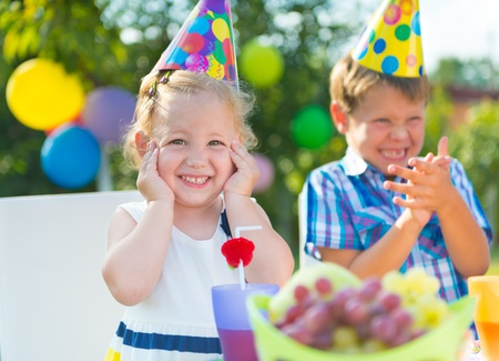 Two happy children having fun at birthday party Standard-Bild