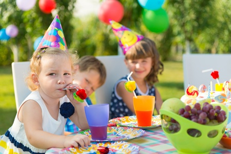 childs birthday party: Pretty girl smilling at childs birthday party  Stock Photo