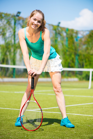 Beautiful female tennis player on the tennis court  photo