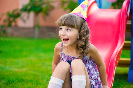 Pretty little girl having fun on playground during birthday party Stock Photo - 22814011