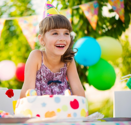Modern birthday party with colorful cake at backyard photo