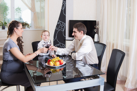 Young family of three celebrating at home photo