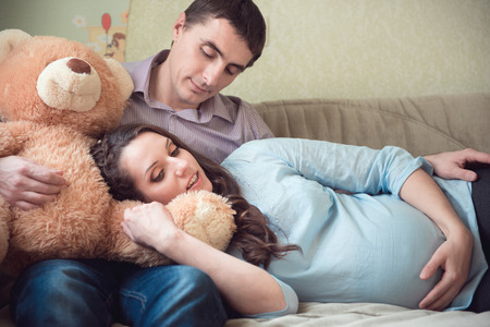 Happy young couple anticipating childs birth photo