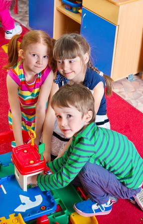 Cute kids playing on the floor at kindergarten