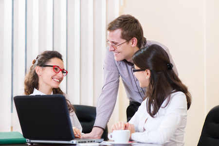 Three young executives working at modern office photo