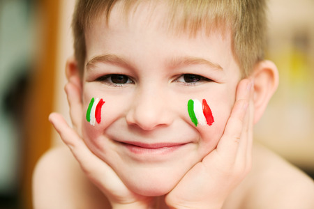 italy flag: Cute little boy with European flags on cheeks Stock Photo
