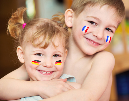 Cute little brother and sister with European flags on cheeks Stock Photo - 27579955