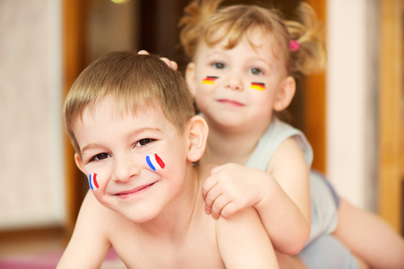 Cute little brother and sister with European flags on cheeks Stock Photo - 27579964