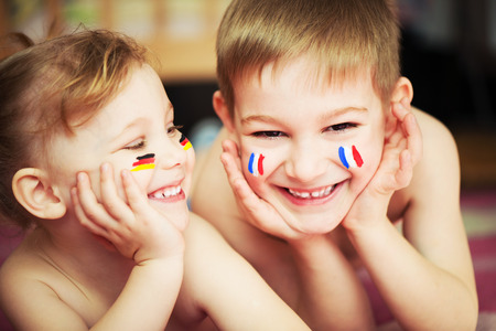Cute little brother and sister with European flags on cheeks Stock Photo - 27579968