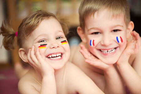 Cute little brother and sister with European flags on cheeks Stock Photo - 27579974