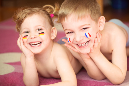 Cute little brother and sister with European flags on cheeks Stock Photo - 27579985