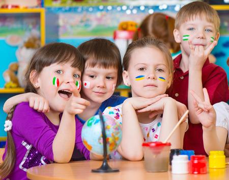 Happy children in language camp studying geography Standard-Bild