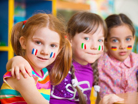 Happy children in language camp studying geography Stock Photo