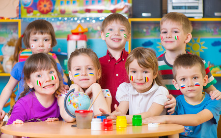 human geography: Happy children in language camp studying geography Stock Photo