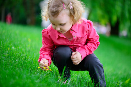 Sweet little girl outdoors with curly hair in park Stock Photo - 29038784