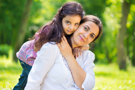 indian happy family: Pretty mother with her daughter at summer park