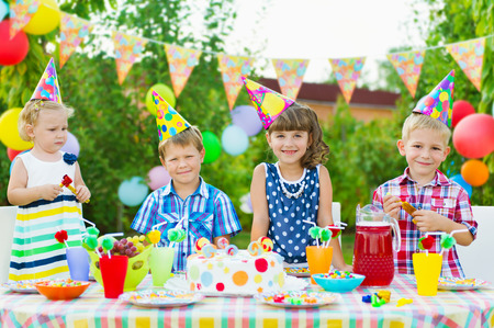 Outdoor birthday party for toddlers with colorful cake