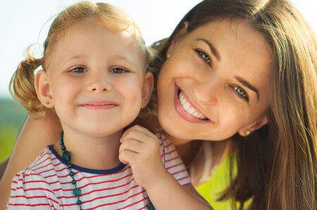 Closeuo portrait of a beautiful young mother and her little baby вфгпреук photo