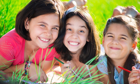 Three happy teen girls having fun at park Stock Photo