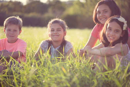 diverse family: Group of several children resting in international camp